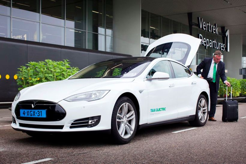<i>A Tesla Model S taxi picks up a passenger at Schiphol, Amsterdam's international airport.</i>