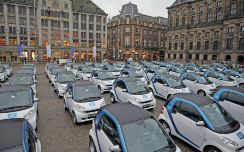 <i>Electric cars fill Dam Square during car2Go's Amsterdam launch in 2011 .</i>