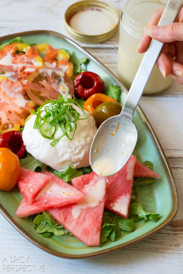"""<strong>Get the <a href=""""http://www.aspicyperspective.com/watermelon-salad-with-burrata-and-yogurt-dressing/"""" target=""""_blank"""""""