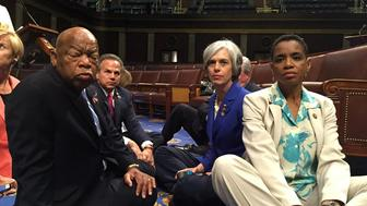 "A photo tweeted from the floor of the U.S. House by Rep. Donna Edwards (R) shows Democratic members of the U.S. House of Representatives, including herself and Rep. John Lewis (L) staging a sit-in on the House floor ""to demand action on common sense gun legislation"" on Capitol Hill in Washington, United States, June 22, 2016.  REUTERS/Rep. Donna Edwards/Handout"