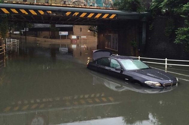 A partly submerged car in