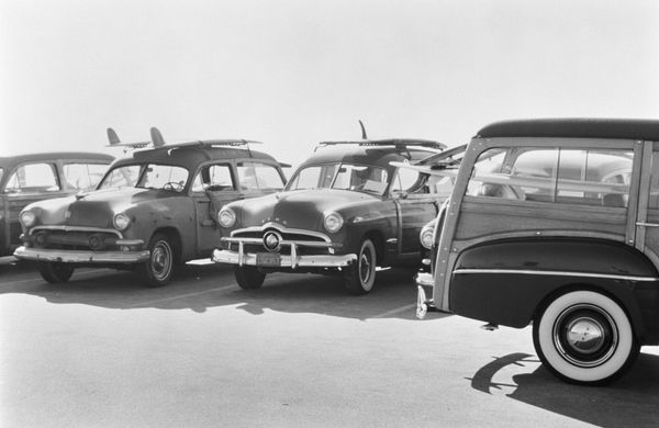 "These cars, also known as ""Woodie Wagons,"" were an integral part of the American surf culture in the 1950s and 1960s."