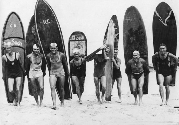 Surfers of Sydney, Australia, carry their boards across the beach. (1933)