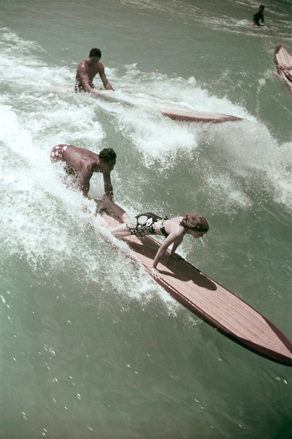 Surfers in the water in Hawaii.