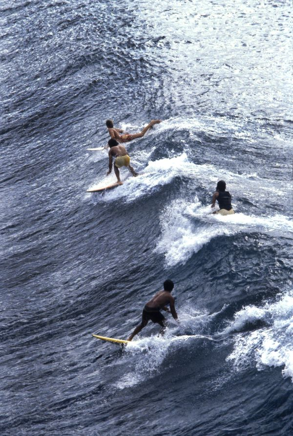 Surfers in Honolua Bay on the island of Maui on January 3, 1980.