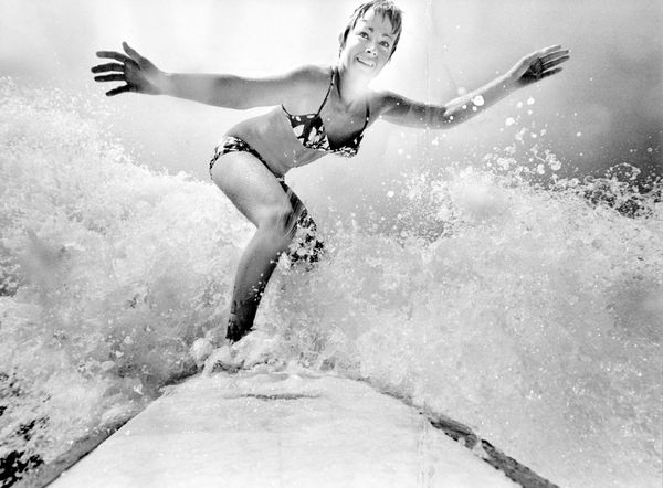 World surfing champion Linda Benson at Hermosa Beach. (1970)