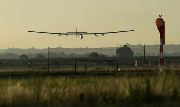 The sun-powered Solar Impulse 2 aircraft lands at Seville Airport in southwest Spain on