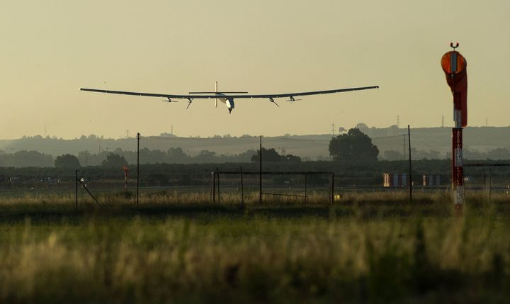 The sun-powered Solar Impulse 2 aircraft lands at Seville Airport in southwest Spain on Thursday