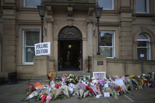 Floral tributes to slain MP Jo Cox adorn Batley Town Hall as people cast their votes in the EU