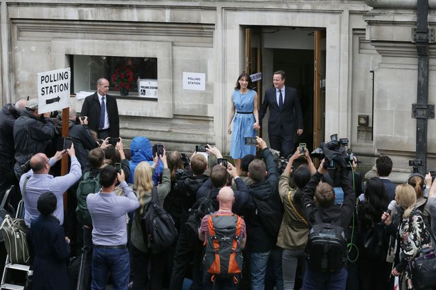David Cameron and his wife Samantha leave after casting their votes in the EU referendum at a polling...