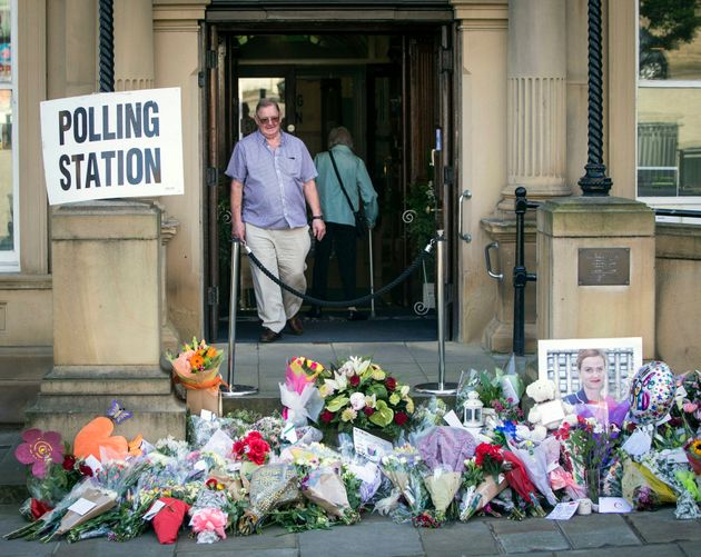 Electors walked past the tributes as they went to go and vote