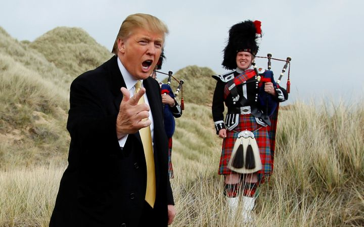 Donald Trump gestures during a media event on the sand dunes of the Menie estate, the site for Trump's proposed golf resort,
