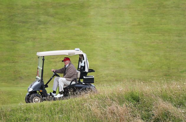 Trump pictured in a golf buggy on the Turnberry golf course last