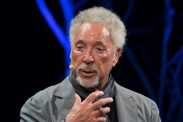 Tom Jones made his first appearance following his wife's death at the Hay Festival earlier this