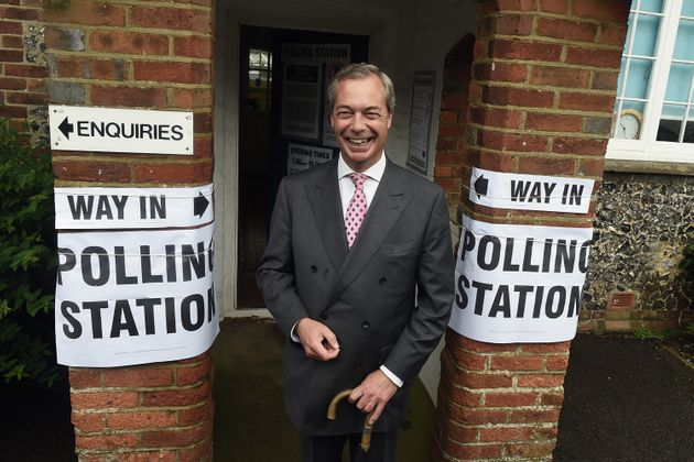 Nigel Farage poses for photographs ahead of