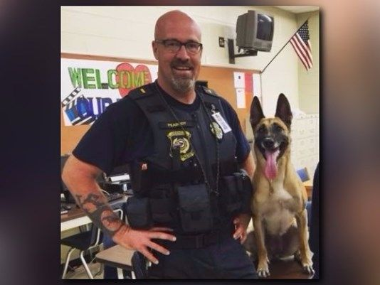 Former Lt. Daniel Peabody, who worked at Cherokee County Schools, is seen with his K9 Inca before her death earlier this month.