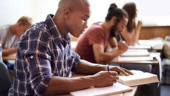 Cropped shot of a young college students in classhttp://195.154.178.81/DATA/istock_collage/0/shoots/783352.jpg