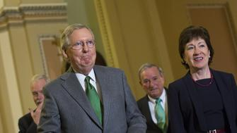 Senate Majority Leader Mitch McConnell, a Republican from Kentucky, left, and Senator Susan Collins, a Republican from Maine, right, arrive for a press conference on Capitol Hill in Washington, D.C., U.S., on Thursday, Dec. 17, 2015. 'This legislation represents a critical step forward,' and is worthy of lawmakers' support, McConnell said. Photographer: Drew Angerer/Bloomberg via Getty Images