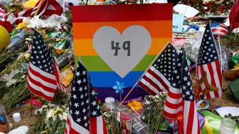 A sign with the number 49 on it is pictured as part of a makeshift memorial following the Pulse night club shootings in Orlando, Florida, U.S., June 20, 2016.  REUTERS/Carlo Allegri