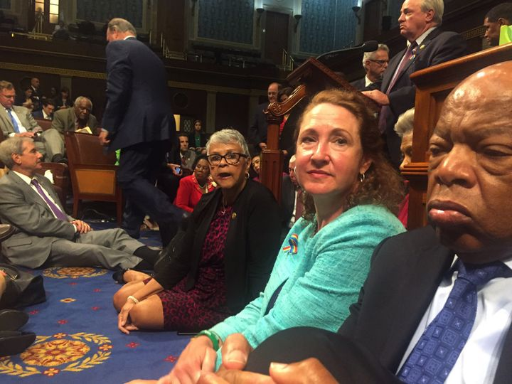 A photo shot and tweeted from the floor of the House by U.S. House Rep. David Cicilline shows Democratic members of the U.S.
