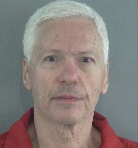 Police say Howard Sparber, 69, fired 33 rounds into the home of a woman he'd been sexually harassing for months.