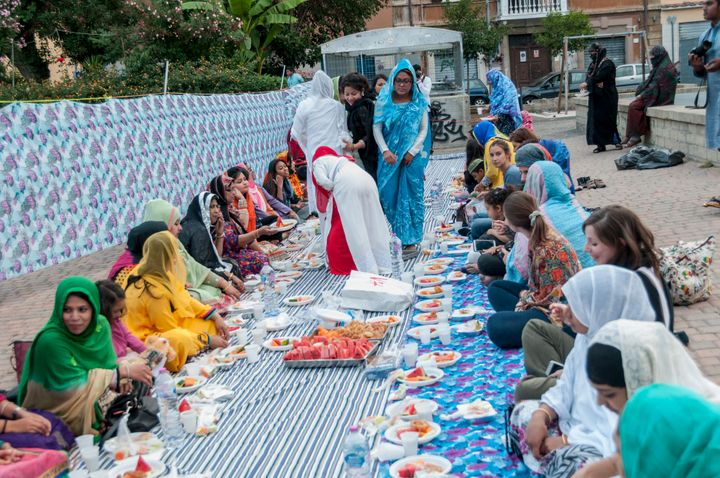 Muslims break their fast at a large community iftar in Rome, Italy.