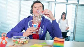 Businessman blowing bubbles in an office