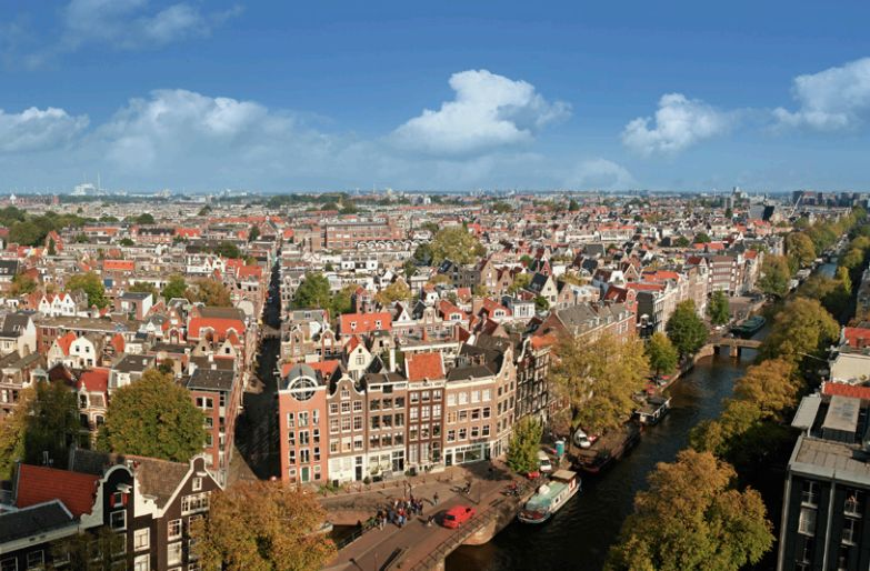 <i>Residential and commercial neighborhoods of Amsterdam stretch as far as the eye can see along Prinsengracht, the longest o