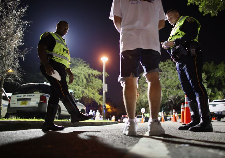 Officers conduct a field sobriety test on a driver during a DUI checkpoint on May 23, 2013 in Miami, Florida.