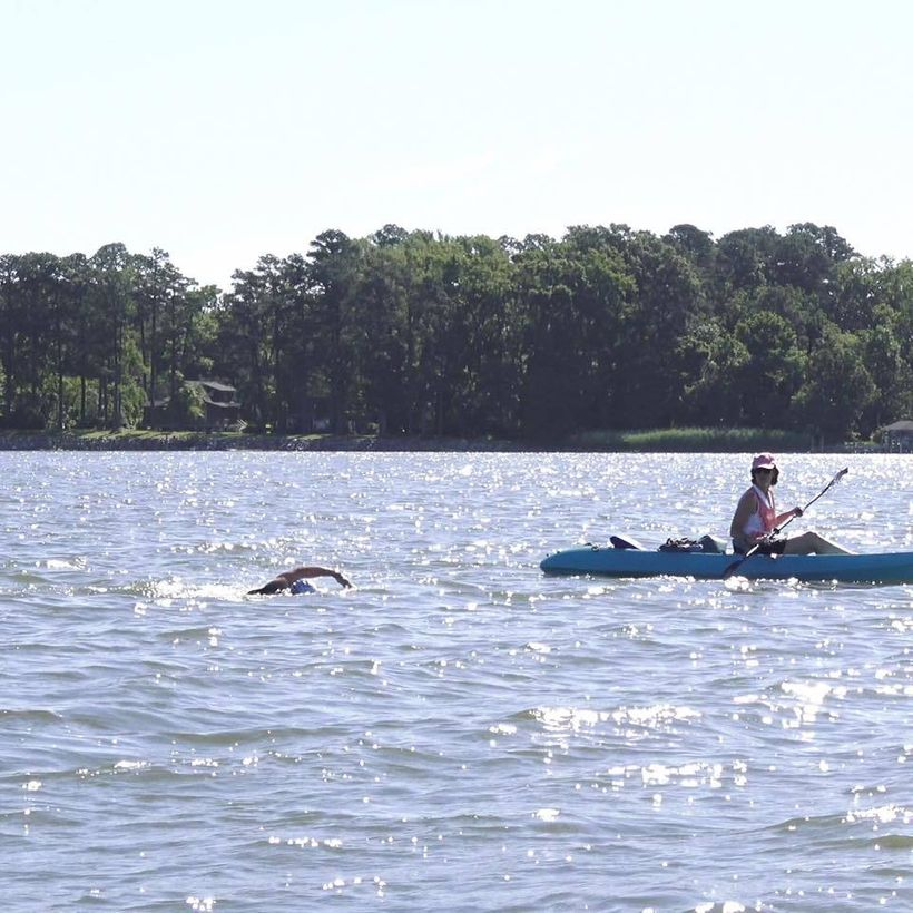 Sam Hitch swims the York River in Virginia as part of his Guinness World Record attempt for longest triathlon.