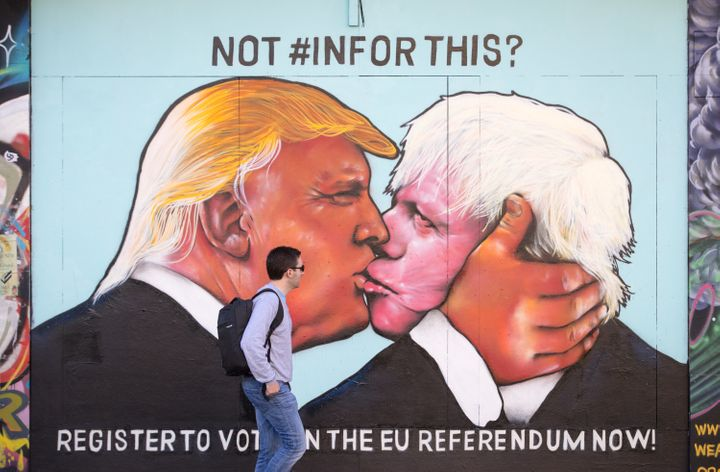 A mural on a derelict building in Stokes Croft shows U.S. presidential hopeful Donald Trump sharing a kiss with former London
