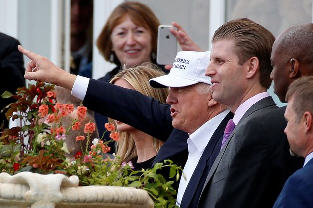 Trump with his son Eric Trump (R) after arriving at Turnberry Golf