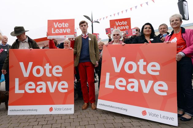 Vote Leave campaigners stand by the Vote Leave campaign bus in Truro,