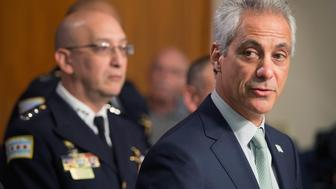 CHICAGO, IL - DECEMBER 30: Interim Chicago Police Superintendent John Escalante (L) listens as Chicago Mayor Rahm Emanuel addresses changes in training and procedures that will take place at the Chicago police department in the wake of recent shootings on December 30, 2015 in Chicago, Illinois. The changes were being announced following the deaths of a 19-year-old college student Quintonio LeGrier and his 55-year-old neighbor Bettie Jones following a domestic disturbance call on December 26. Police claim Jones was killed by accident when officer were shooting at LeGrier who was wielding a metal baseball bat.  (Photo by Scott Olson/Getty Images)