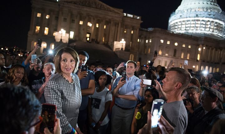 House Minority Leader Nancy Pelosi outside the Capitol during the Democrats' gun protest on Wednesday night. (Photo By Tom Wi