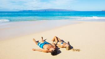 Attractive Couple Relaxing on Sandy Beach, Tropical Vacation