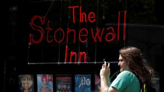 A woman takes a selfie outside outside the Stonewall Inn in the Greenwich Village neighborhood of New York City, U.S., May 9, 2016.  REUTERS/Brendan McDermid