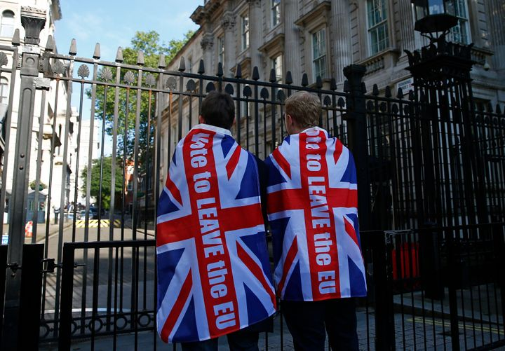 "Britain voted to leave the EU in a referendum on Thursday. ""Leave"" supporters are pictured here outside the prime m"