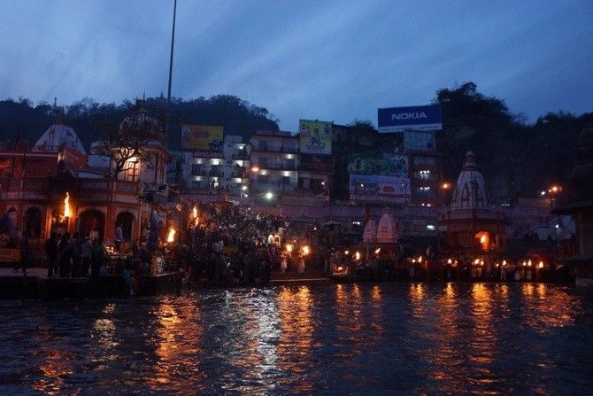 """Evening """"puja"""" along the banks of the River Ganga near Rishikesh in northern India."""