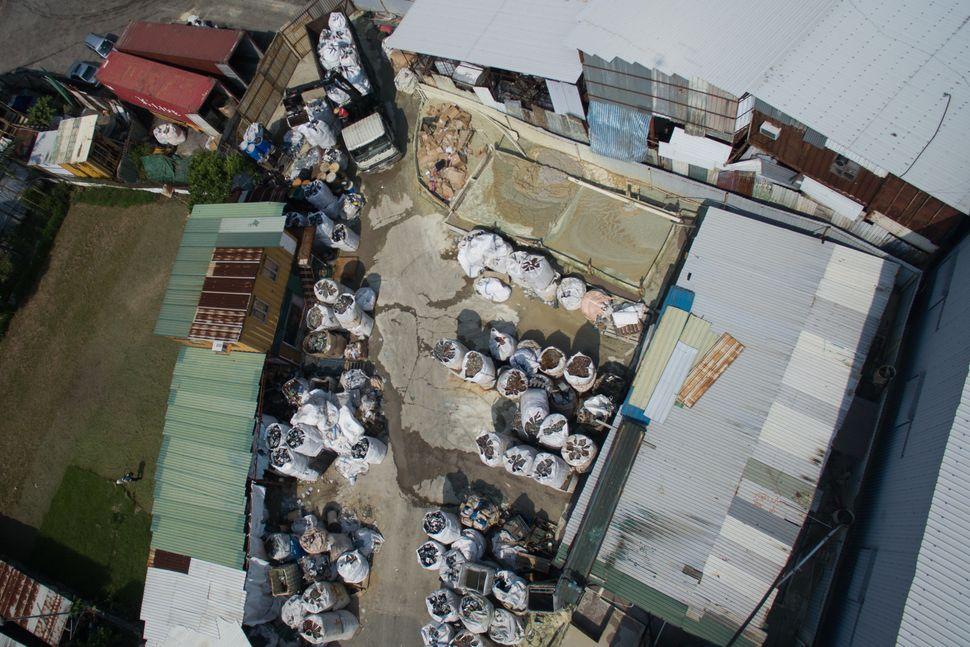 An aerialview of ajunkyard in rural Hong Kong.