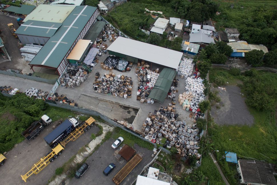 Anotherview of a junkyard and its surroundings.