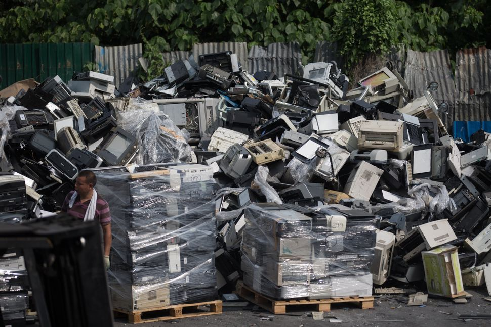 A massive pile of discarded computer equipment.