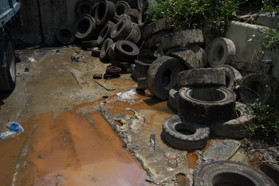 Discarded tires and dirty water at a junkyard in Hong Kong.