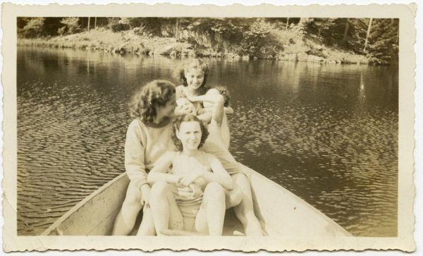 Teenagers in a rowboat at summer camp, from the Records of the Hebrew Orphan Asylum of the City of New York.