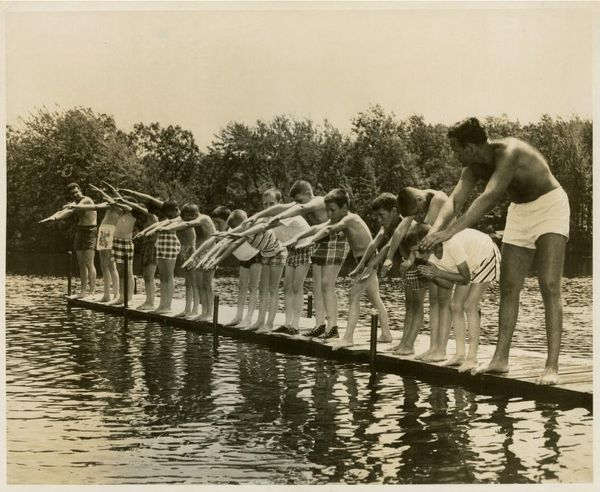 Boys at a swimming lesson at a country camp, circa 1950, from the National Jewish Welfare Board Records.