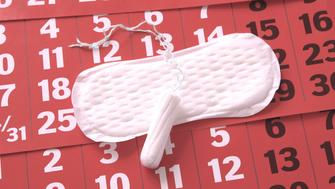 The sanitary napkin lying on a red calendar.