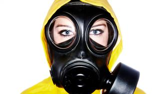 Woman wearing gas mask and protective clothing