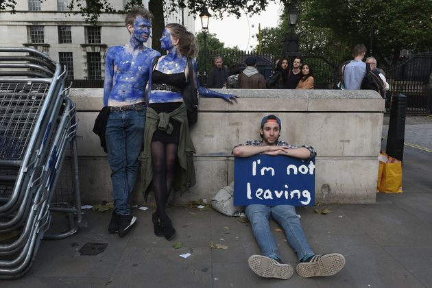People protest against the U.K.'s referendum vote to leave the EU in London on Friday. Some...