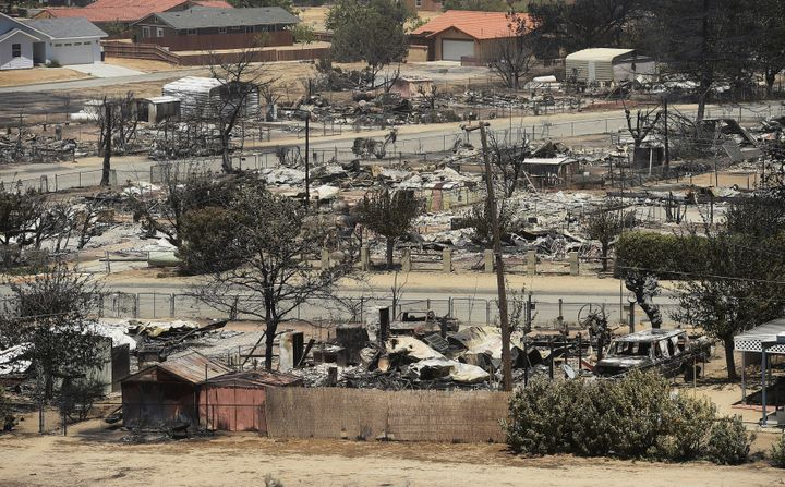 The remains of scorched homes line a street after the Erskine Fire burned through South Lake, California, U.S. June 24, 2016.