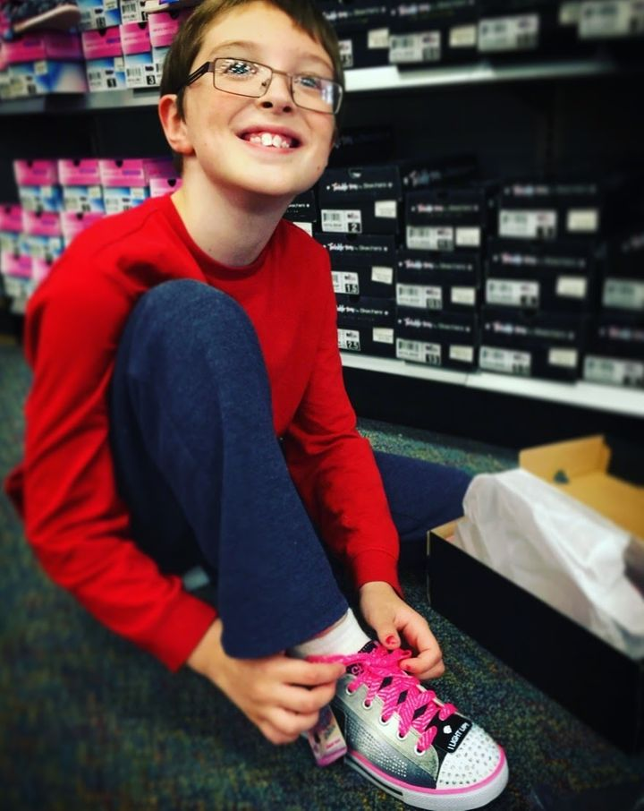 """My rockstar son trying on his """"Twinkle Toes"""" sneakers. Because he can."""